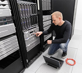 Man working on computer server